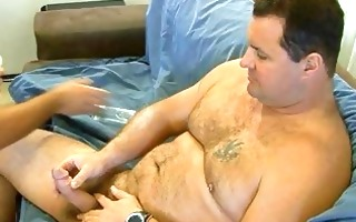 large bear plays with his cock