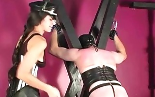 yielding slave spanked with paddle