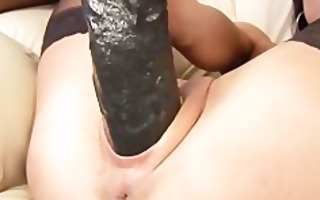 paola fills her slit with a massive dildo