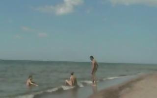 homo threesome beach oral-sex