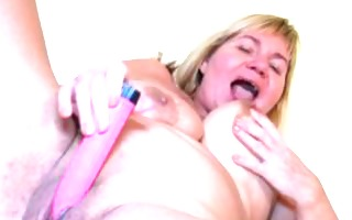 old granny aged does pleasure with a toy on the