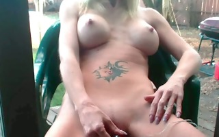 outdoors with her rabbit, she is cums