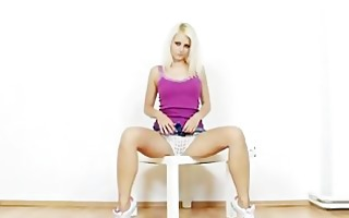 blonde playgirl gemma shows off red stockings